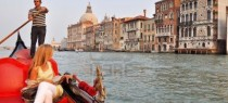 8226007-venice-italy--29-september-2009-an-italian-gondolier-navigates-tourist-through-venice-in-a-gondola-o
